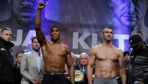 Anthony Joshua and Wladimir Klitschko go head to head during the weigh-in