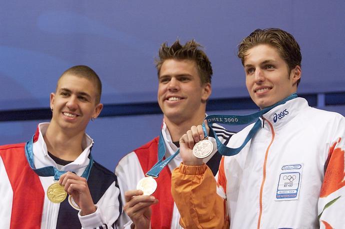 Pierwszy duży sukces Ervin (z lewej) odniósł na igrzyskach w Sydney. W Australii wraz ze swoim rodakiem Garym Hall Jr. (w środku) ex aequo triumfował na 50 m styl. dow. Brąz zdobył Pieter van den Hoogenband.
