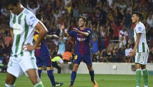 Barcelona's midfielder Sergi Roberto (C) celebrates after scoring during the Spanish league footbal match FC Barcelona vs Real Betis