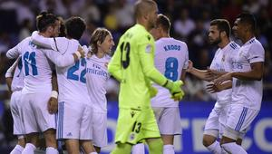 Real Madrid's Welsh forward Gareth Bale (L) celebrates with teammates after scoring during the Spanish league footbal match RC Deportivo de la Coruna vs Real Madrid