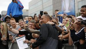 Ruud Gullit has his picture taken with fans during the all-stars game in the fanzone