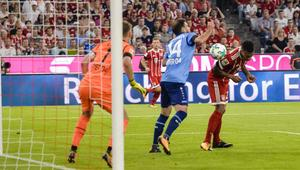 Bayern Munich's French midfielder Corentin Tolisso (R) scores the second goal during the German First division Bundesliga football match FC Bayern Munich vs Bayer 04 Leverkusen