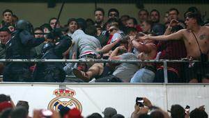 Fans clash with police during the match