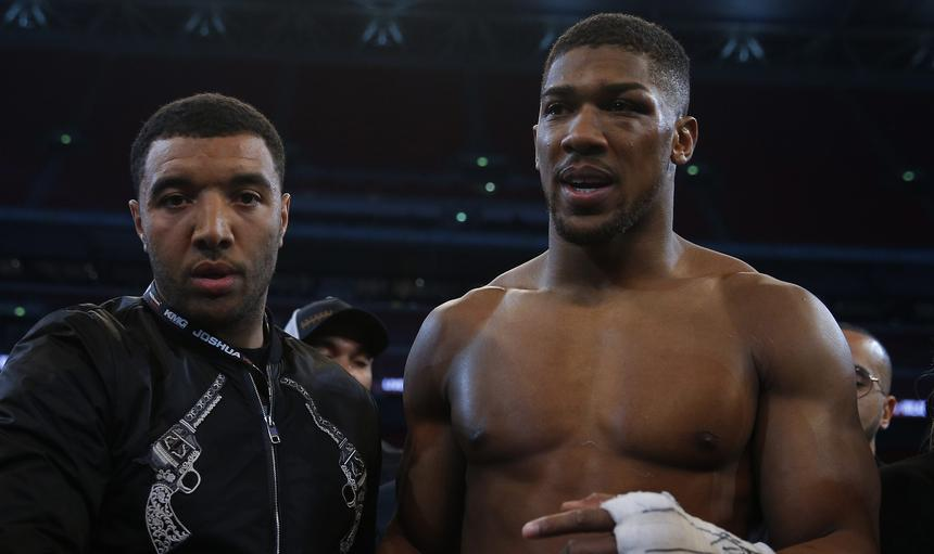 Anthony Joshua with Watford's Troy Deeney after the fight