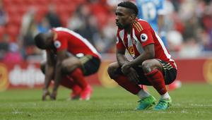 Sunderland's Jermain Defoe and Victor Anichebe look dejected