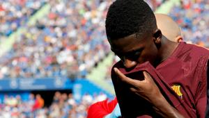 Barcelona's record signing Dembele reacts as he leaves the pitch after sustaining an injured during his Spanish La Liga match against Getafe