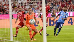 Bayern Munich's defender Niklas Suele (2nd R) score the opening goal of the season past Leverkusen