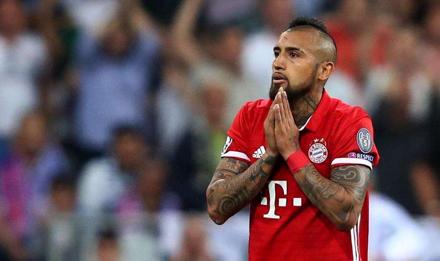 Bayern Munich's Arturo Vidal looks dejected after being sent off