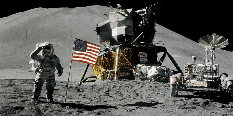 FILE PHOTO: Astronaut James Irwin, lunar module pilot, gives a military salute while standing beside the U.S. flag during Apollo 15 lunar surface extravehicular activity (EVA) at the Hadley-Apennine landing site on the moon, August 1, 1971. NASA/David Scott/Handout via REUTERS