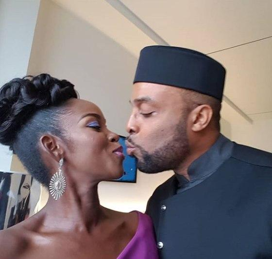Kalu Ikeagwu and wife share a kiss just before walking on the red carpet of the 2018 AMVCAs.