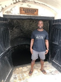 Akwasi Frimpong standing by the famous Cape Coast slave castle in Ghana, May 21, 2019