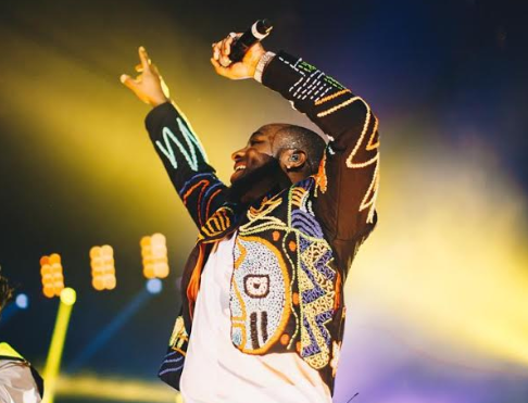Davido wears a hand-beaded OKUNOREN jacket at his sold-out concert