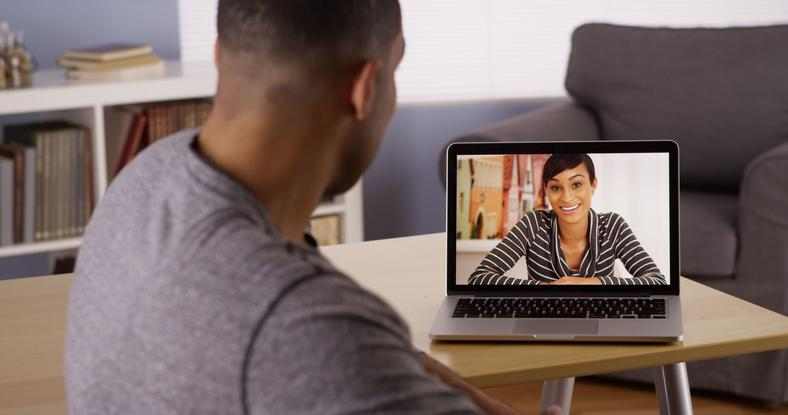 A couple doing a video chat [Credit: Spiritual Singles]
