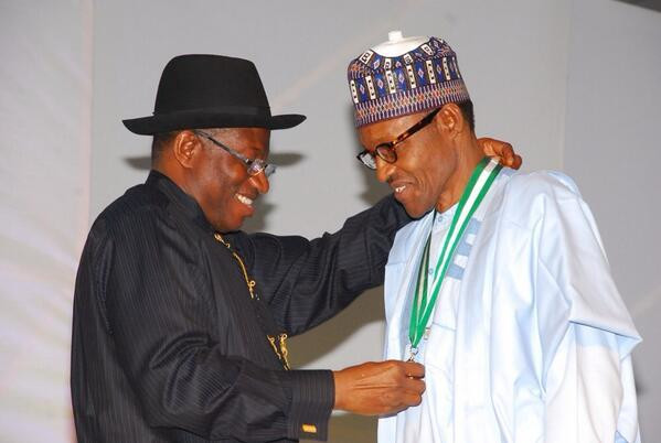 Jonathan decorates Buhari with a medal of honour during the transition period (The Nation)