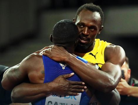 Bolt grli Getlina posle londonskog finala