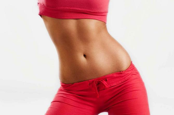 4757_+-stock-photo-slim-tanned-tight-woman-s-body-in-sport-wear-studio-white-shutterstock_32975617