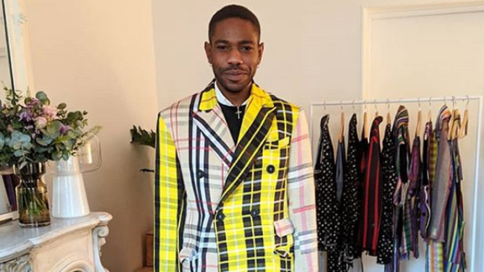Nigerian designer Kenneth Ize wearing one of his woven designs [Credit: Primetweets]