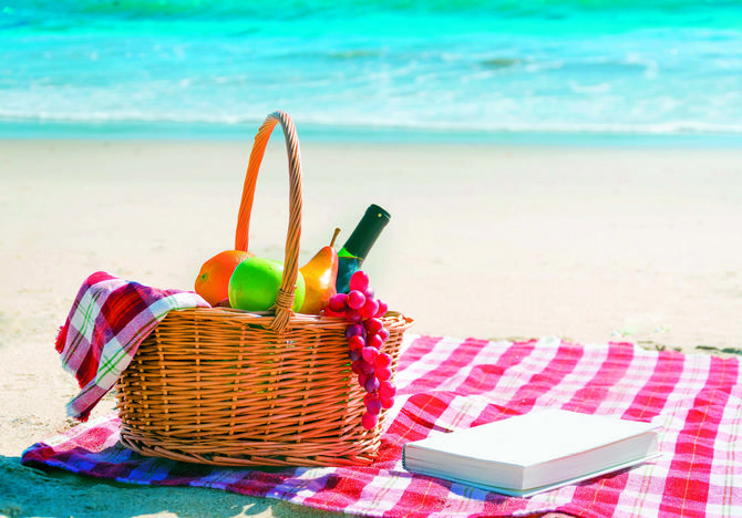 stock-photo-picnic-background-with-basket-fruits-and-book-by-the-ocean-255215800