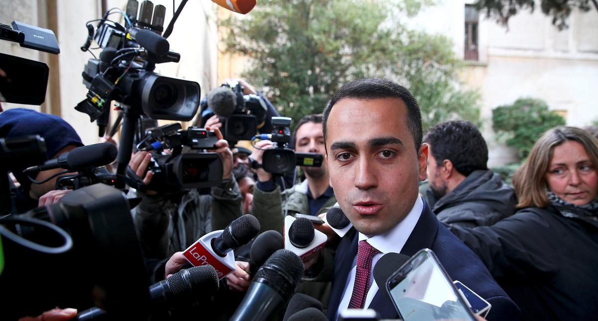 5-Star Movement leader Luigi Di Maio speaks to journalists as he arrives at the Link Campus Universi