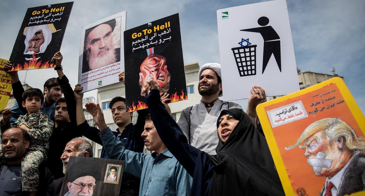 Iranians shout slogans during a protest against President Donald Trump's decision to walk out of a 2