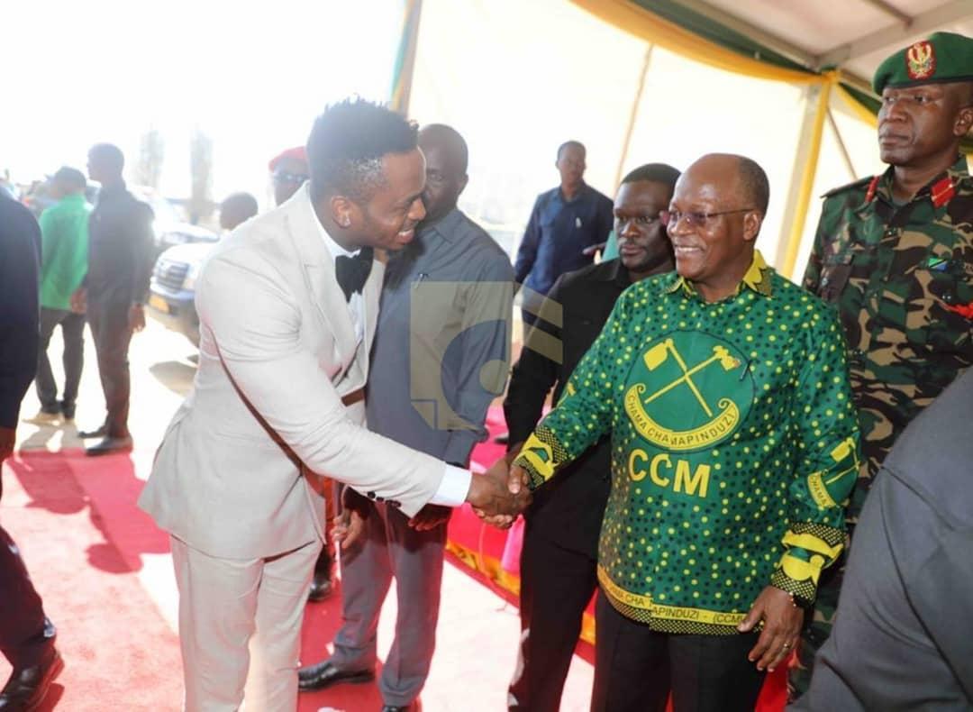 President Magufuli shaking hands with Diamond.