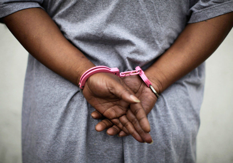 Image result for pictures of Nigerian woman handcuffed