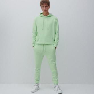 Reserved - Spodnie dresowe z bawełną - Zielony