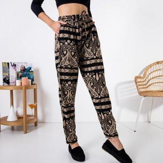 Czarne materiałowe spodnie damskie we wzorki - Odzież