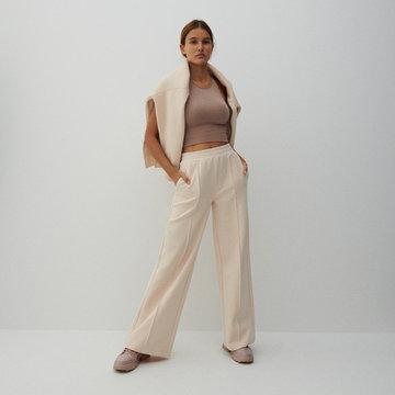 Reserved - Szerokie spodnie z kantem - Kremowy