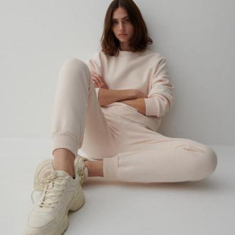 Reserved - Spodnie z bawełną organiczną - Kremowy