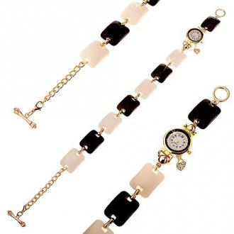Czarno-biały zegarek na rękę, wypukłe prostokąty, cyferblat z bezbarwnymi cyrkoniami