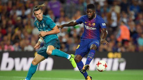 Bale w walce z Umtitim/ źr. AFP / LLUIS GENE