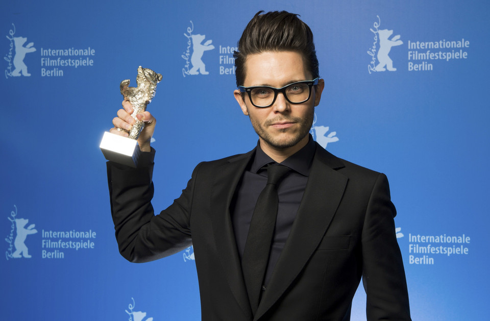 Wasilewski poses backstage with the Silver Bear award for the best script for his film 'United States of Love' during the awards ceremony of the 66th Berlinale International Film Festival in Berlin