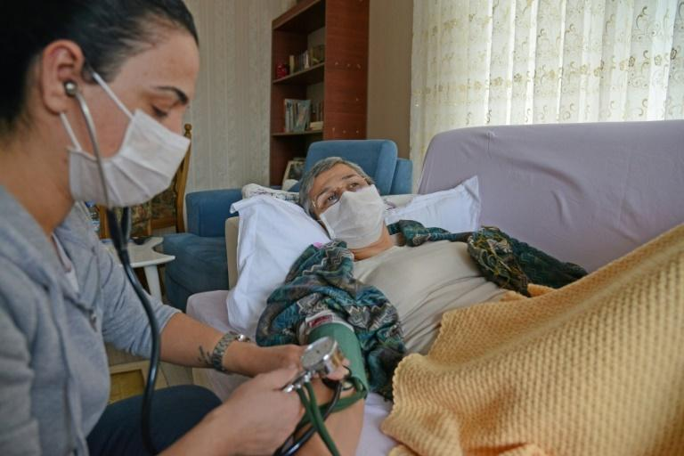 Guven is accompanied by a voluntary health care professional, and her blood pressure is constantly checked