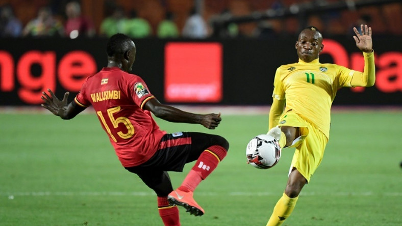 A file photo of Zimbabwe star Khama Billiat (R) playing against Uganda during the 2019 Africa Cup of Nations in Egypt