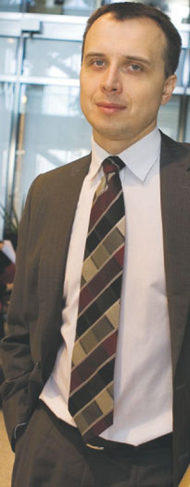 Michał Grzybowski, dyrektor w Ernst & Young Fot. Wojciech Górski