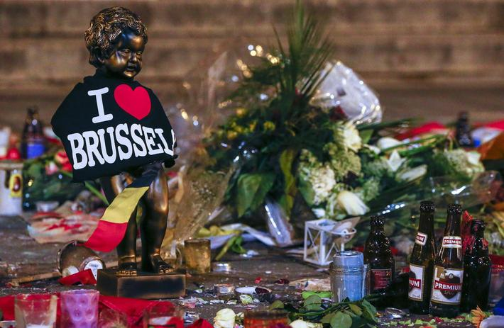 A replica of the Manneken-Pis statue, a major Brussels tourist attraction, is seen among flowers at