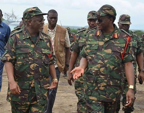 Tanzania's President John Magufuli (L) in full military gear. (BigEye)