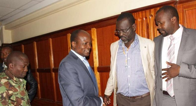 Migori Governor Okoth Obado his co-accused Caspal Obiero and Michael Oyamo