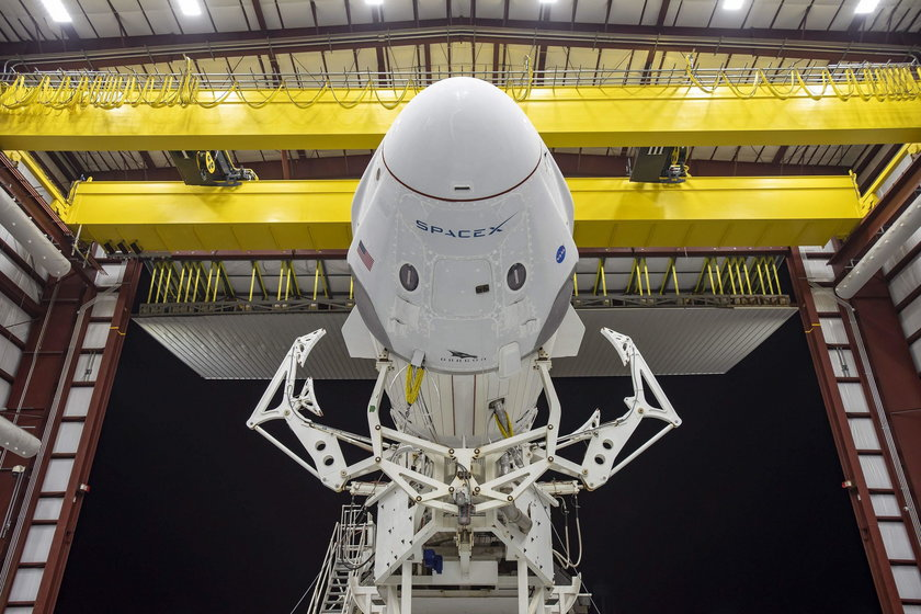 A SpaceX Falcon 9 rocket, with the Crew Dragon atop, stands poised for launch at historic Launch Com