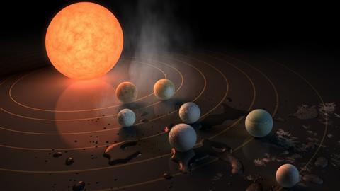 Wyobrażenie artysty na temat gwiazdy TRAPPIST-1, ultrazimnego czerwonego karła, i siedmiu krążących wokół niej planet