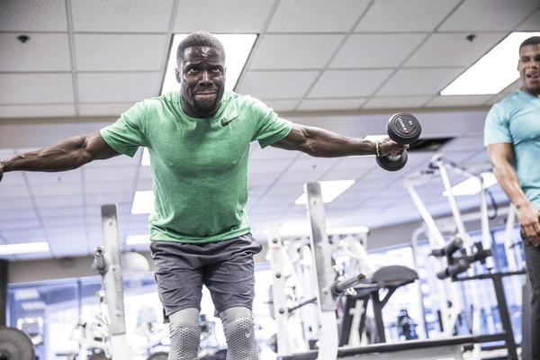 Kevin Hart working out in the gym