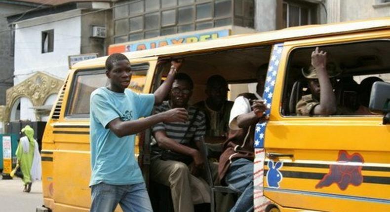 Lagos bus conductor.
