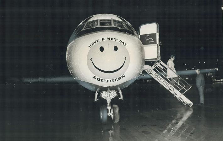 Ironic slogan on plane's nose: Southern Airways executive jet sits on tarmac at Malton airport early