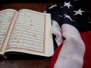 The Koran and and the U.S. flag are seen on the podium before a vigil in honor of New Zealand mosque attack victims at Dar Al-Hijrah Islamic Center in Falls Church