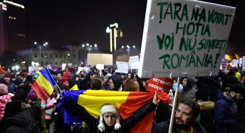 Demonstrators protest in front of the government headquarters in Bucharest, on February 3, 2017