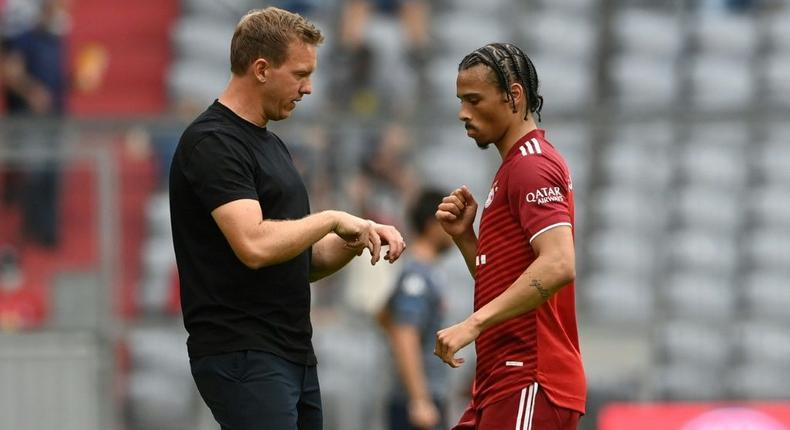 Bayern Munich coach Julian Nagelsmann (L) says Leroy Sane (R) is better off playing on the left wing Creator: Christof STACHE