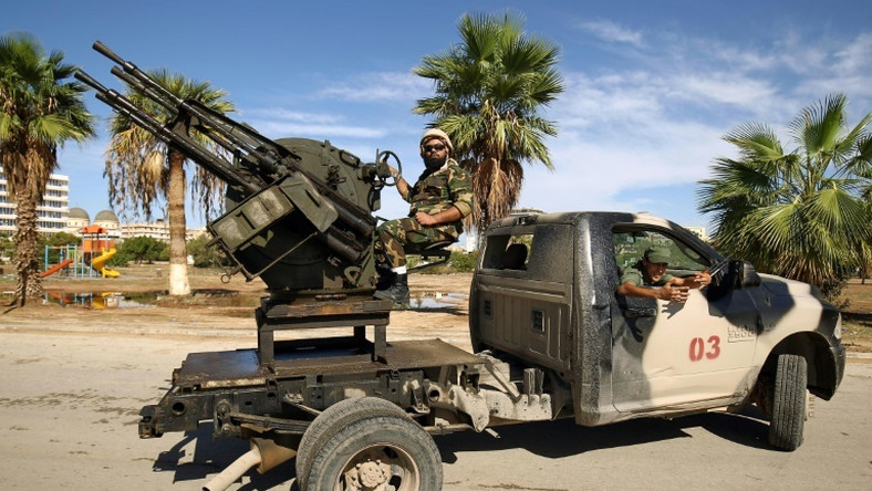 Forces loyal to Libyan strongman Khalifa Haftar man pickup trucks in Benghazi on October 24, 2018