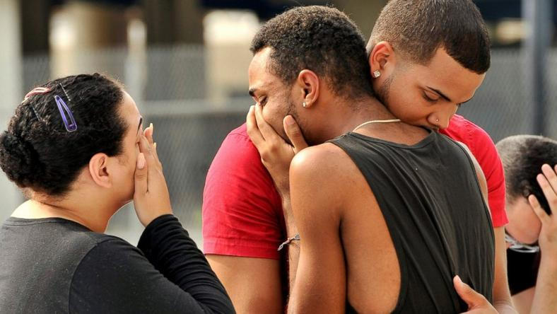 Mourners comfort themselves following Orlando shooting which left 50 people dead.