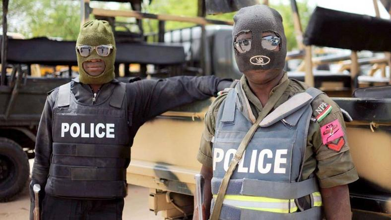 Masked police officers